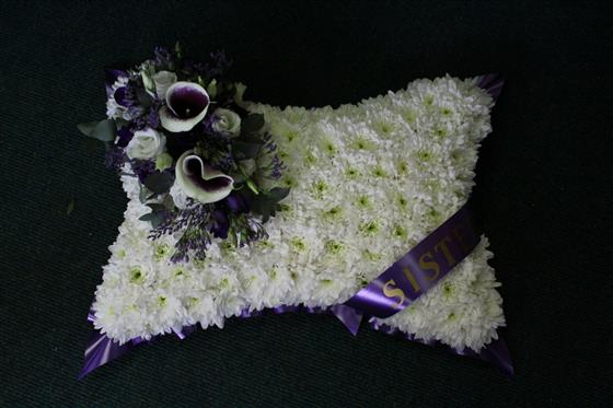 Massed white and Purple pillow